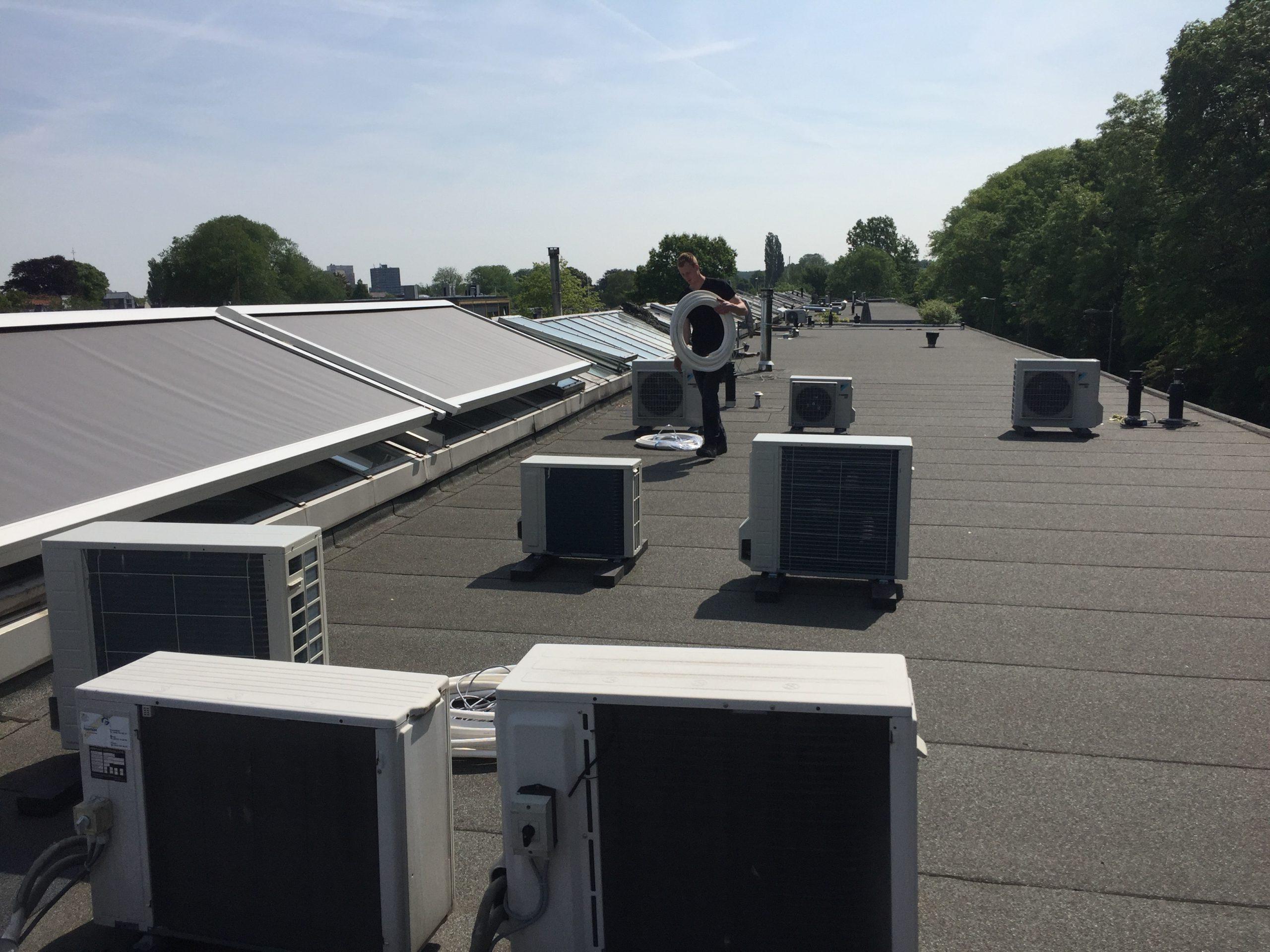 Spruijt Klimaat - Hoogwerker Amsterdam airco VRV systeem Spruijt Klimaat dak